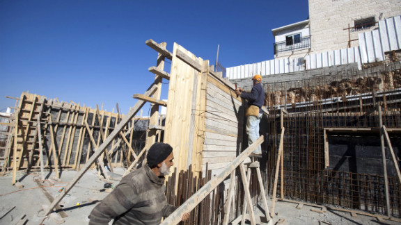 Palestinian laborers work on a construction site in the east Jerusalem settlement of Ramat Shlomo, on December 18, 2012.