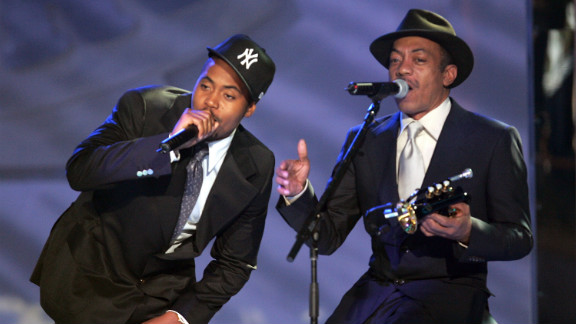 "Nas and his father, Olu Dara, perform during the VH1 Hip-Hop Awards in New York City in 2004. Nas' father is a jazz cornet player and is featured on the rapper's 2004 track, ""Bridging the Gap,"" along with a Muddy Waters sample."