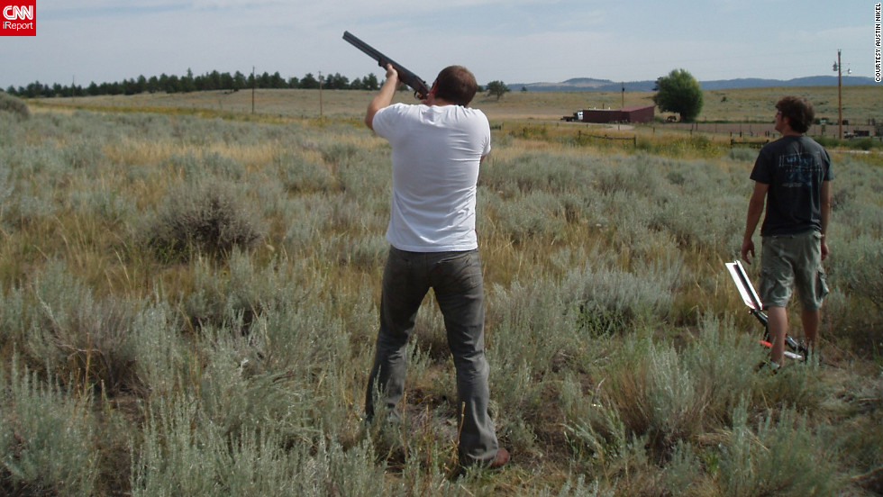 Austin Nikel and his brother used a shotgun to shoot clay targets during this outing in Wyoming in 2009. Other enthusiasts of military style rifles often use them to hunt deer and other game. But some states have banned the AR-15 and its .223 caliber for deer hunting.