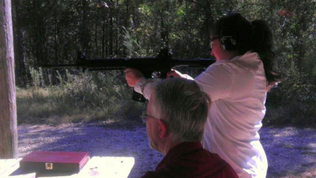 Robin says her father taught her and her daughter, pictured shooting, how to use guns safely.
