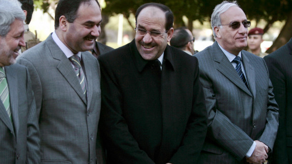 Iraqi Finance Minister Rafei al-Essawi is shown second from left, next to Prime Minister Nuri al-Maliki, in 2008.