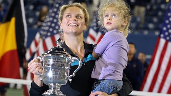 Kim Clijsters with daughter Jada and the 2010 U.S. Open trophy after beating Vera Zvonareva in the final.