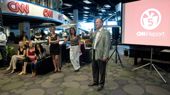 Walton congratulates the staff of CNN.com on the fifth anniversary of iReport in August 2011.