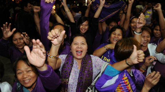 Supporters of the RH Bill celebrate, as lawmakers pass the landmark birth control legislation on December 17.