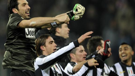 Juventus players including goalkeeper Gianluigi Buffon celebrate their last-gasp win over Cagliari.