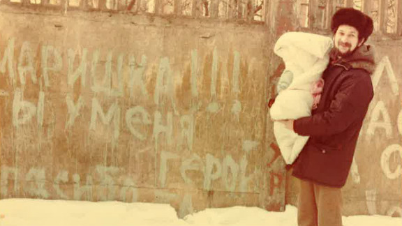 Unable to see his sick wife for a week after she gave birth, Lev Furman painted a message on a wall outside the hospital.