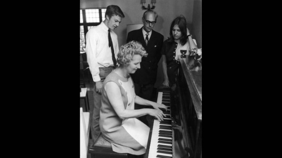 Thatcher plays the piano for her husband, Denis, and their twins, Mark and Carol, then 17, in September 1970.