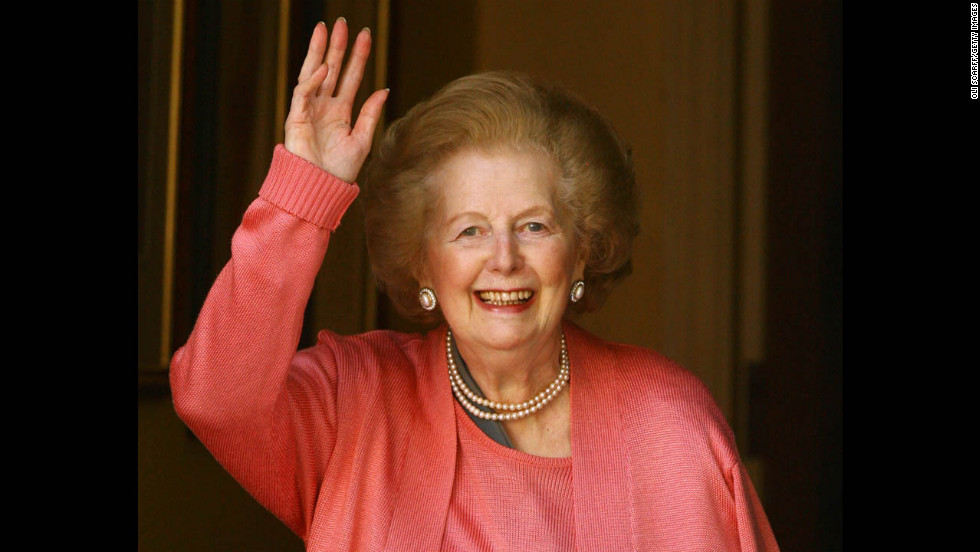 Thatcher waves from the door of her London home after a hospital stay to operate on a broken arm in June 2009. She had a pin placed in her shoulder after suffering a fall.