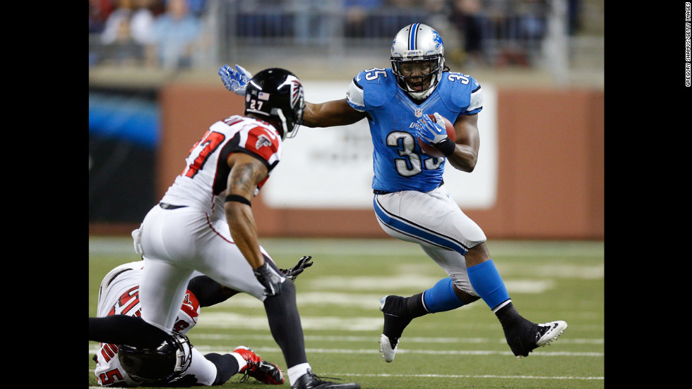 Joique Bell of the Detroit Lions tries to get around the tackle of Robert McClain of the Atlanta Falcons on Saturday.
