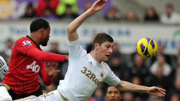 Patrice Evra gave Manchester United a 16th minute lead at Swansea after heading home Robin van Persie