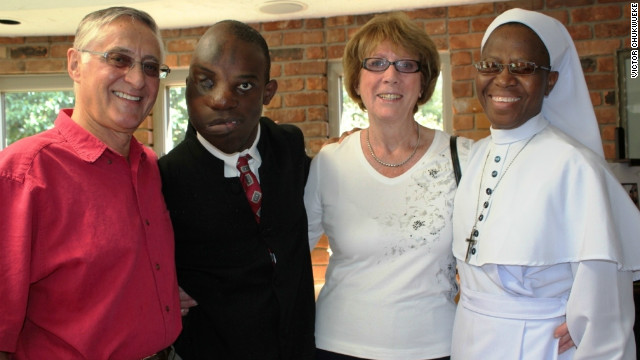 Victor Chukwueke (second from the left) is shown with his surgeon, Dr. Ian Jackson, the doctor's wife and the nun who has cared for him since he came to the United States.