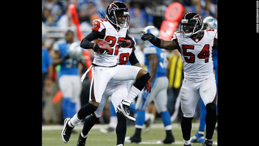 Asante Samuel of the Atlanta Falcons reacts after a fourth quarter interception next to Stephen Nicholas while playing the Detroit Lions at Ford Field on Saturday, December 22, in Detroit. Atlanta won the game 31-18.