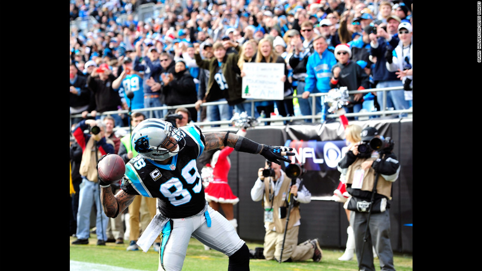 Steve Smith of the Panthers throws the ball into the stands after scoring a touchdown against the Raiders on Sunday.