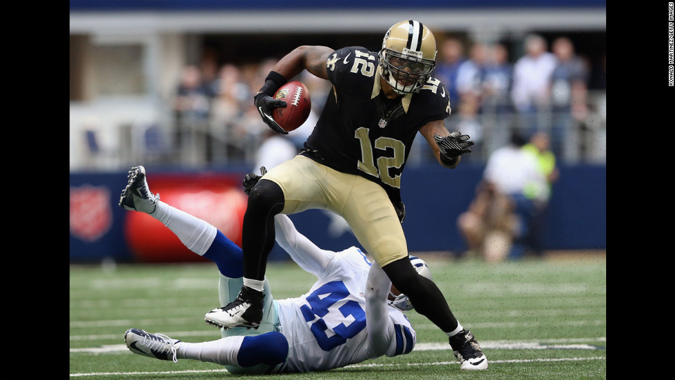 Marques Colston of the Saints runs the ball past Gerald Sensabaugh of the Cowboys on Sunday.