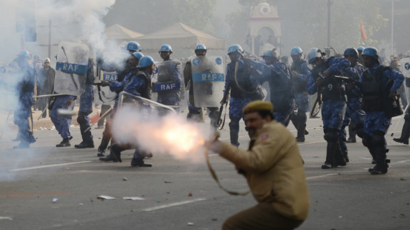 Police fire tear gas on Sunday, December 23, during a protest calling for better safety for women following last week's rape. Thousands of protesters defied a ban on demonstrations in New Delhi on Sunday, venting their anger about the incident.