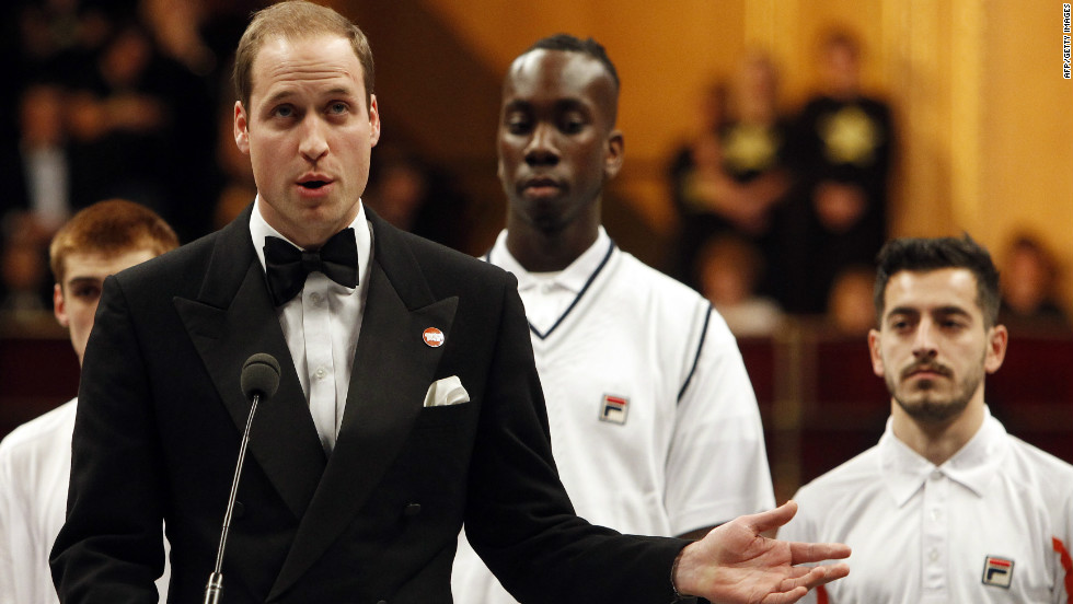 Britain's Prince William, Duke of Cambridge, speaks alongside young people for the Centrepoint charity at the Royal Albert Hall in London on December 8, 2012. The prince, 30, also met with Serbian tennis player Novak Djokovic at the Winter Whites Gala.
