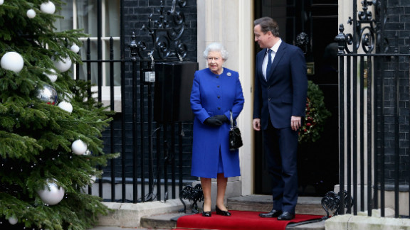 The queen is greeted by Prime Minister David Cameron as she arrives at Number 10 Downing Street to attend the Government