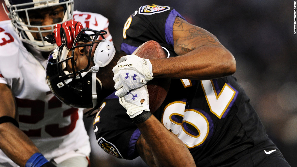 Wide receiver Torrey Smith of the Baltimore Ravens makes a catch past cornerback Corey Webster of the New York Giants in the first quarter at M&T Bank Stadium on Sunday in Baltimore.