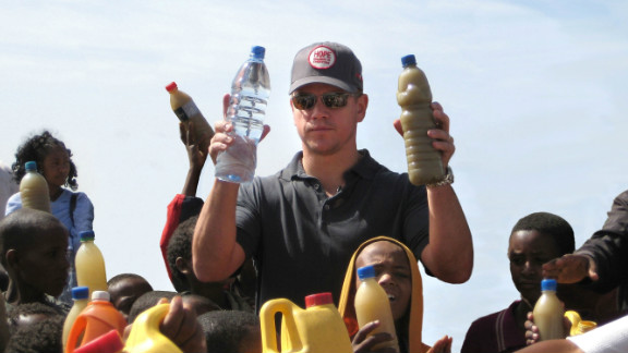 Actor Matt Damon hands out clean drinking water to children in Ethiopia. Damon helped found water.org in 2009.