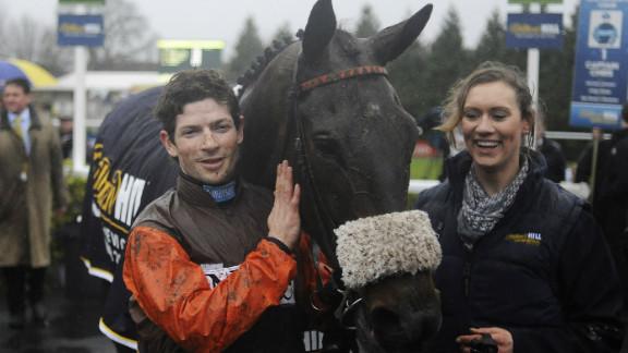 Jockey Sam Waley-Cohen celebrates with Long Run after their King George VI success at Kempton Park.