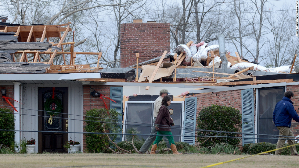 Workers clean up tornado damage near Troy, Alabama, on Wednesday, December 26, 2012.