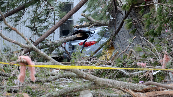 The storm winds knocked down trees, destorying cars and homes near Troy, Alabama, on December 26.