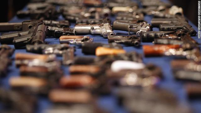 Illegal firearms confiscated in a weapons bust in New York's East Harlem is on display at an October news conference.