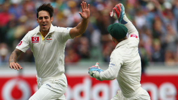 Mitchell Johnson, left, celebrates with wicketkeeper Matthew Wade after dismissing Tillakaratne Dilshan in the opening over of Sri Lanka's second innings in Melbourne.