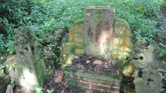 This grave at Bukit Brown cemetery has two guardian lions.