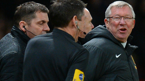 Alex Ferguson shouts at assistant referee Andy Garrett in scenes reminiscent of the midweek 4-3 win over Newcastle, after which the United manager was widely criticized for harrassing match officials.