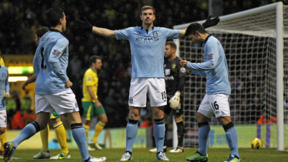 Edin Dzeko had put the visitors 2-0 ahead inside five minutes, and the recalled Bosnian striker was involved in the decisive fourth goal -- his shot hit the post and rebounded into the net off Norwich goalkeeper Mark Bunn, who was credited with an own-goal.
