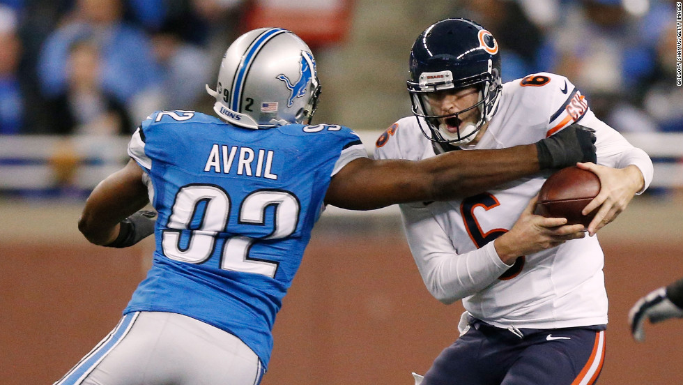 Jay Cutler of the Chicago Bears avoids a tackle by Cliff Avril of the Detroit Lions on Sunday.