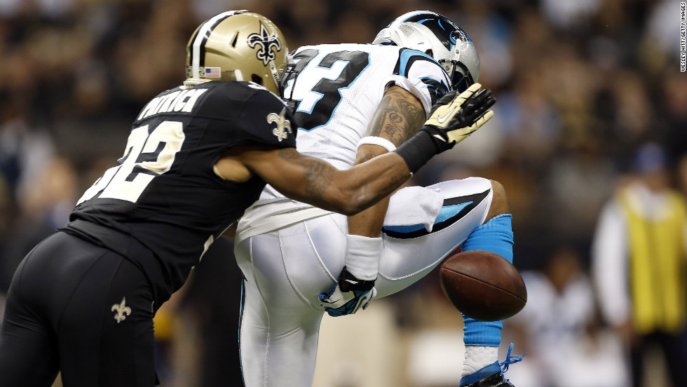 Louis Murphy of the Carolina Panthers drops a pass while covered by Johnny Patrick of the New Orleans Saints on Sunday.