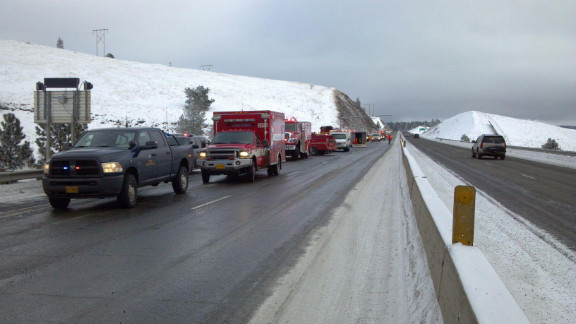 Oregon State Police and emergency responders arrive at the scene of a fatal bus crash east of Pendleton on Sunday.