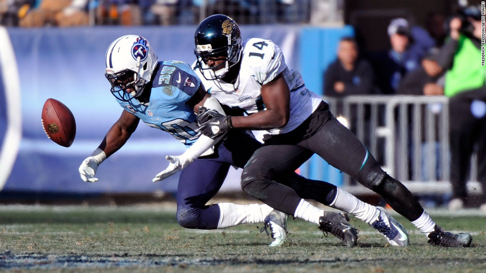 Jason McCourty of the Tennessee Titans and Justin Blackmon of the Jacksonville Jaguars fight to catch a pass on Sunday.