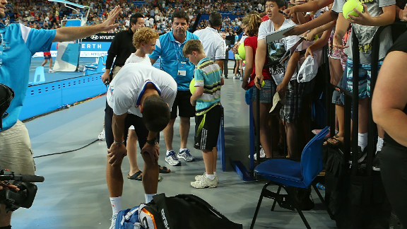 Novak Djokovic composes himself in the aftermath of an incident when a spectator barrier collapsed at the Hopman Cup.