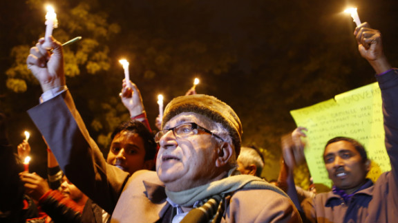 Indian protesters hold candles during a rally in New Delhi on Sunday, December 30, following the cremation of the gang-rape victim.