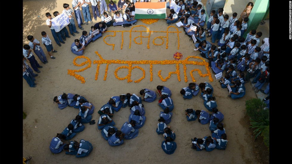 Indian children used their 2013 celebration to pay homage to the New Delhi gang-rape victim in Ahmedabad on Monday.