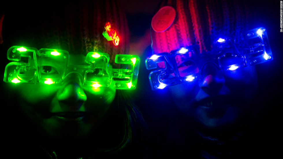 Revellers wear 2013-style glasses as they celebrate the new year in Beijing.