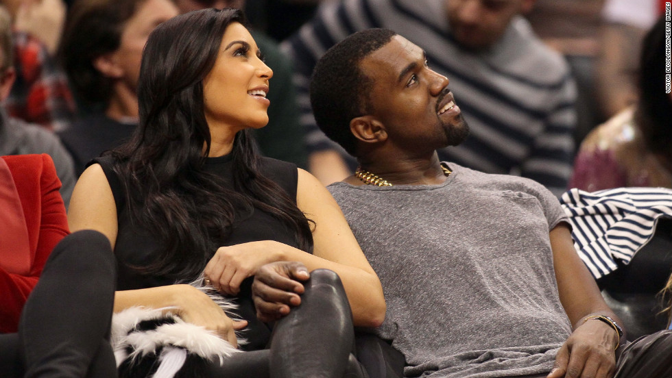 Kim and Kanye were all smiles as they cuddled up at one of their favorite haunts: courtside at a basketball game, this time watching the Denver Nuggets face the Los Angeles Clippers on December 25, 2012. By the following Sunday, Kanye spilled the beans that they were expecting daughter North.