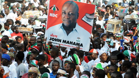 Ghana's ruling National Democratic Congress supporters carry a picture of Ghanaian President John Dramani Mahama who was re-elected in early December.