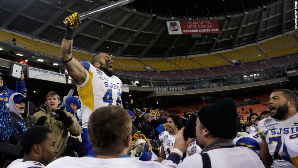 Ray Rodriguez of the San Jose State Spartans leads a cheer after defeating the Bowling Green Falcons 29-20 to win the Military Bowl on December 27.