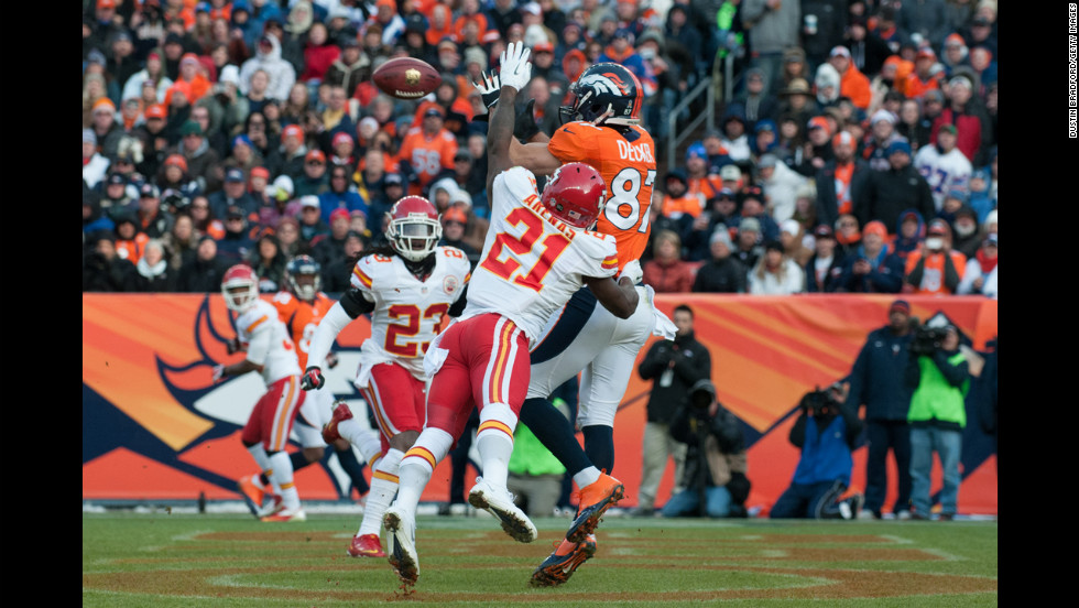 Wide receiver Eric Decker of the Denver Broncos catches a touchdown pass under coverage by cornerback Javier Arenas of the Kansas City Chiefs on Sunday.