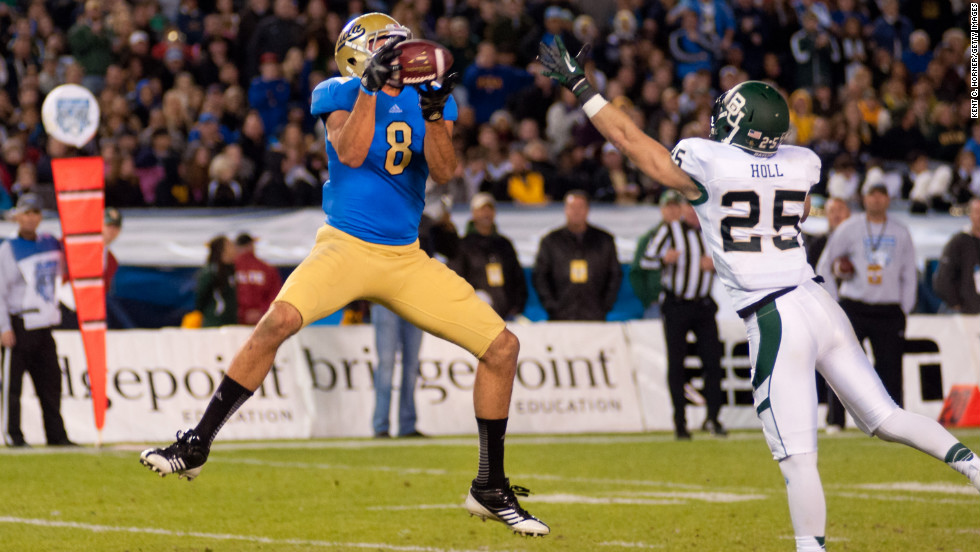 UCLA's Joseph Fauria leaps to catch the ball in the first half against Baylor's Sam Holl on December 27.