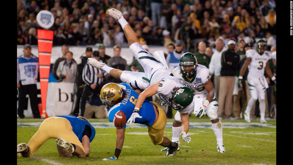Jordan Najvar of the Baylor Bears is upended and fumbles the ball in the first half of the game as Eric Kendricks of the UCLA Bruins makes the tackle in the Bridgepoint Education Holiday Bowl at Qualcomm Stadium on December 27 in San Diego.