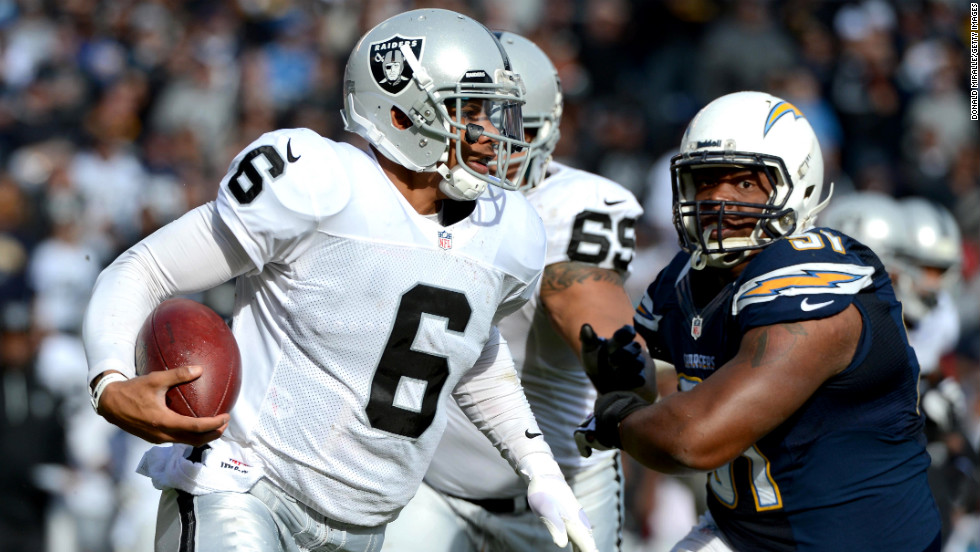 Terrelle Pryor of the Oakland Raiders runs the ball against the San Diego Chargers on Sunday.