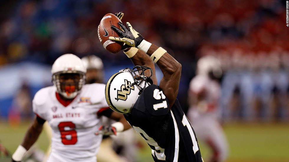 Josh Reese of the Central Florida Knights loses a pass against the Ball State Cardinals during the Beef 'O' Brady's Bowl at Tropicana Field on Friday, December 21, in St. Petersburg, Florida.