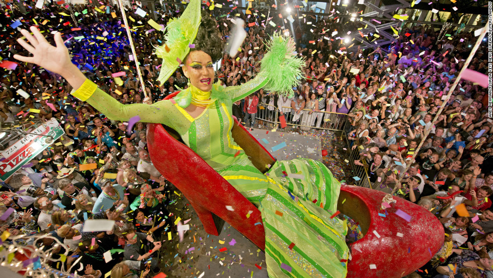 Gary Marion, portraying female impersonator Sushi, hangs in an oversized replica of a women's red high heel over Duval Street in Key West, Florida. The Red Shoe Drop has become a Key West tradition.