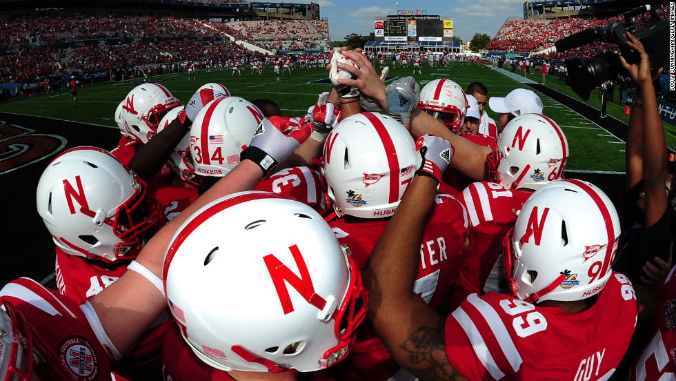 Nebraska players huddle before the Capital One Bowl against Georgia  on January 1 in Orlando, Florida.