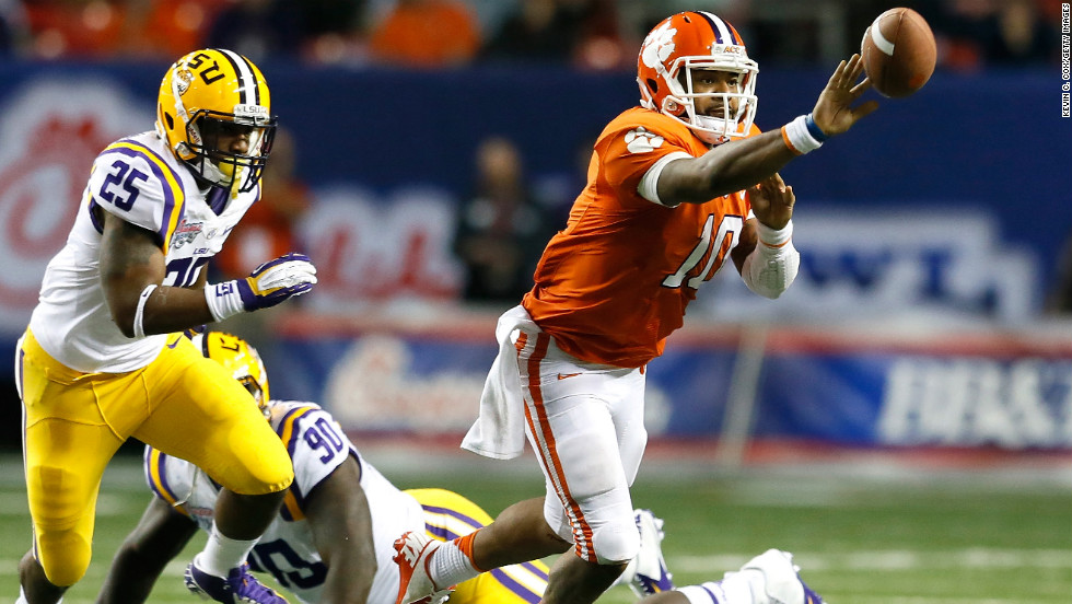 Tajh Boyd of the Clemson Tigers pitches the ball away from Kwon Alexander of the LSU Tigers on December 31.